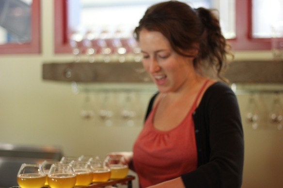 Abby pouring a flight in the Allagash Tasting Room, Photo by Phil Tracy